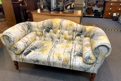 Contemporary Sofa in Floral Fabric with bolster cushions. £365